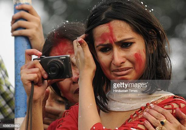 A young devotee during Immersion of idol of Goddess Durga in the river Hoogly on October 4 2014 in Kolkata India Durga Puja commemorates the slaying...