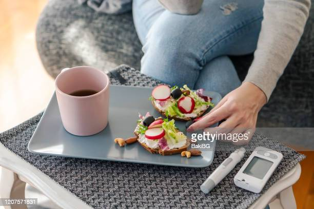 young diabetic woman having breakfast at home - diabetes stock pictures, royalty-free photos & images