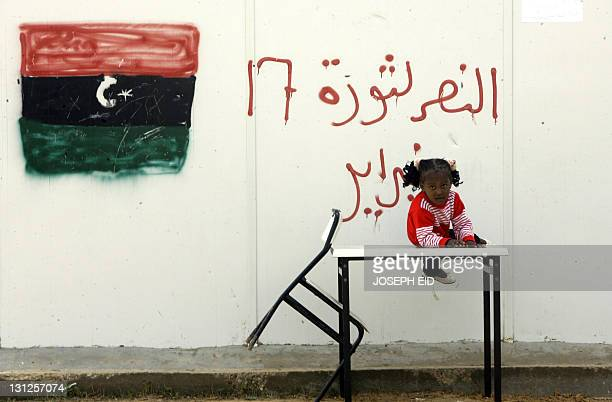 A young displaced Libyan girl from the city of Tawarga lives with her family in prefabricated houses set up for workers at a construction site in...