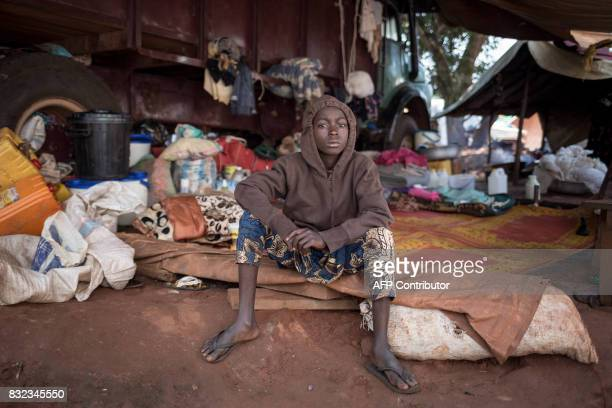 TOPSHOT A young displaced poses for a photograph at the displaced muslims refugee camp of the Catholic minor seminary in Bangassou southeastern...