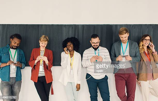 Young Diversity People Using their smart phones.