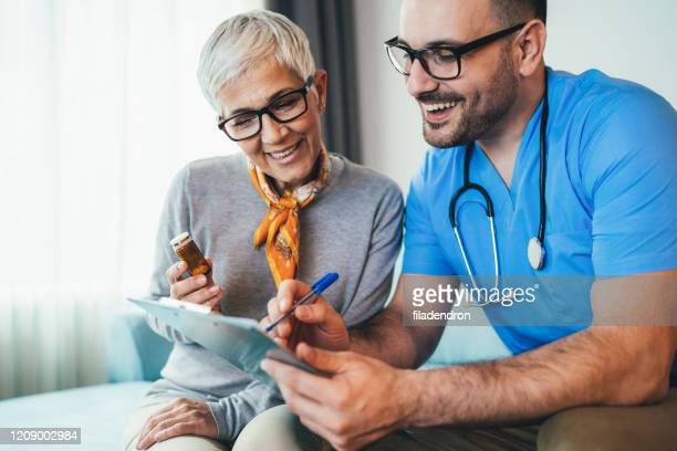 young doctor and senior woman - diabetes pictures stock pictures, royalty-free photos & images