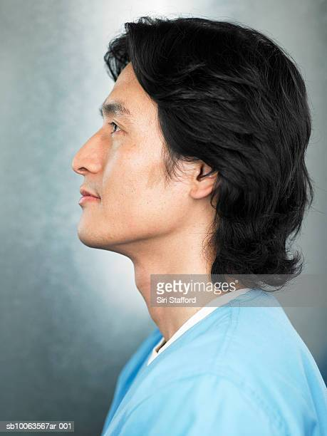young doctor in scrubs, profile - 横顔 ストックフォトと画像