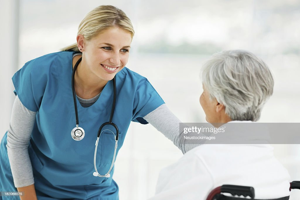 Young Doctor Speaking With an Elderly Patient : Stock Photo