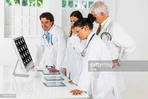 young doctors  watching cat scan picture on monitor - human liver stock photos and pictures