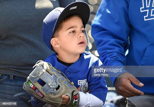 A young Dodgers fan looks on during batting practice before a baseball game on Opening Day between the Los Angeles Dodgers and the San Diego Padres...
