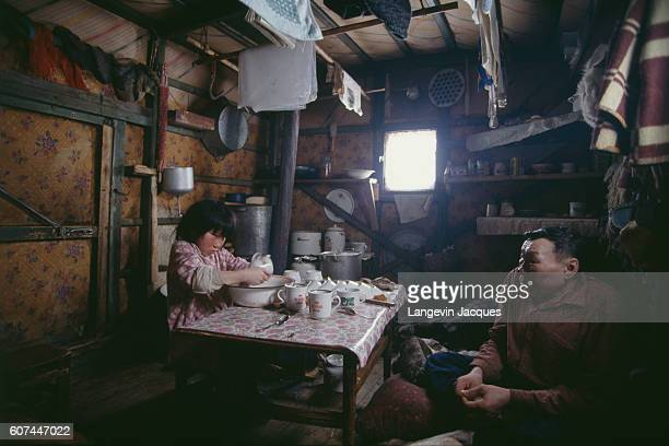 A young Dolgan girl washes dishes in her home near the village of Syndassko Russia The Dolgans traditionally a nomadic people who live along the...