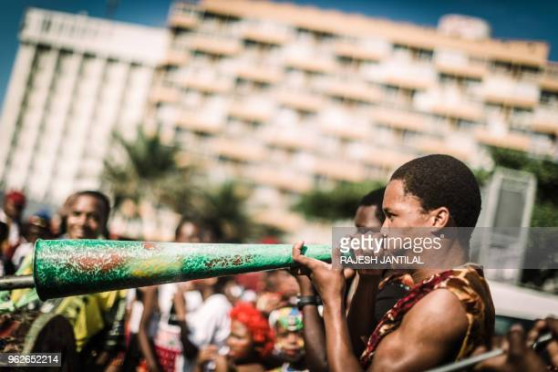 Young drummers and trumpeters take part on May 26 2018 in a street carnival festival in Durban to celebrate Africa Month a month that sees Africans...
