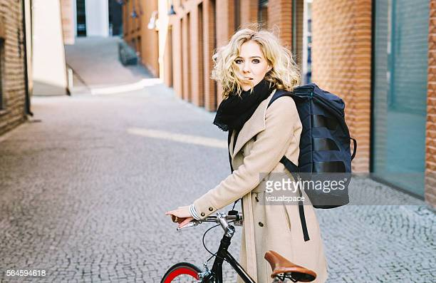 Young Dynamic Attractive Woman Cycling In The City