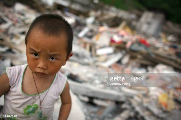 Young earthquake survivor stands amidst the rubble of what used to be his home on June 4, 2008 in Shifang, Sichuan province, China. More than 69,000...
