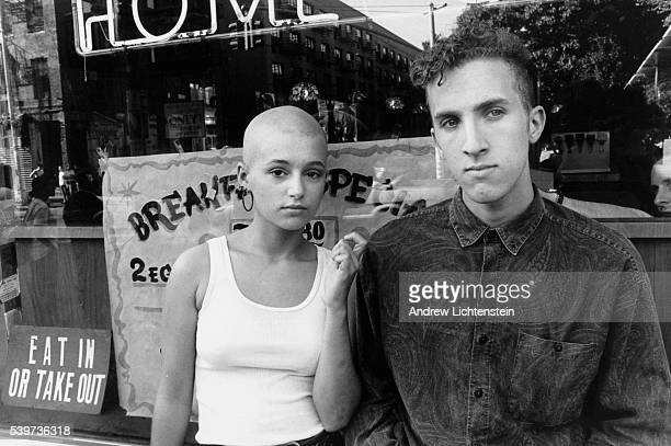 A young East Village couple standing outside Leschka's a popular and cheap Polish diner on Avenue A in Manhattan