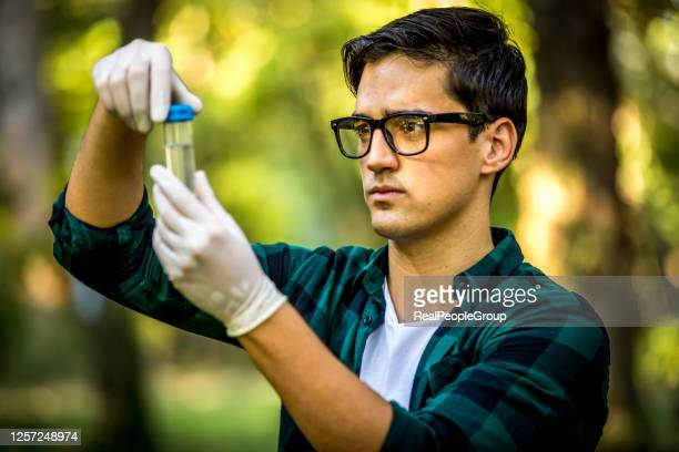 young ecologist man in the forest - ecologist stock pictures, royalty-free photos & images