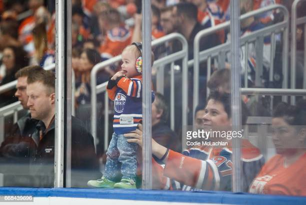 A young Edmonton Oilers fan gets a look as the Edmonton Oilers take on the San Jose Sharks in Game One of the Western Conference First Round during...