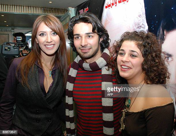 Young Egyptian actors Hiba Abdul Aziz Ahmed Hatim and Mona Hala during a press conference for their new film 'Lamh alBasar' in Cairo on December 1...
