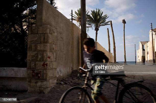 Young Egyptian rides a bicycle in the city of El Arish, the capital of Egypt's restive North Sinai region, September 19, 2012. The area is at the...