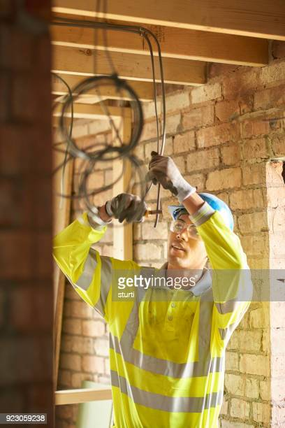 young electrician on construction site