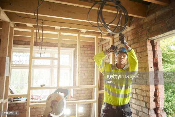young electrician on site - cable stock pictures, royalty-free photos & images