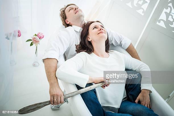 Young elegant couples in bathtub