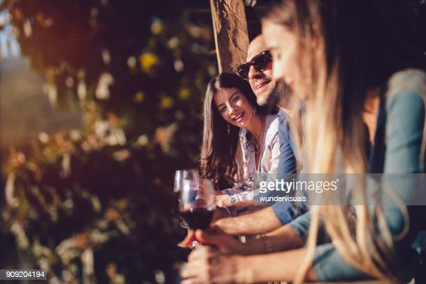 young elegant friends wine tasting at rustic cottage patio - france stock pictures, royalty-free photos & images