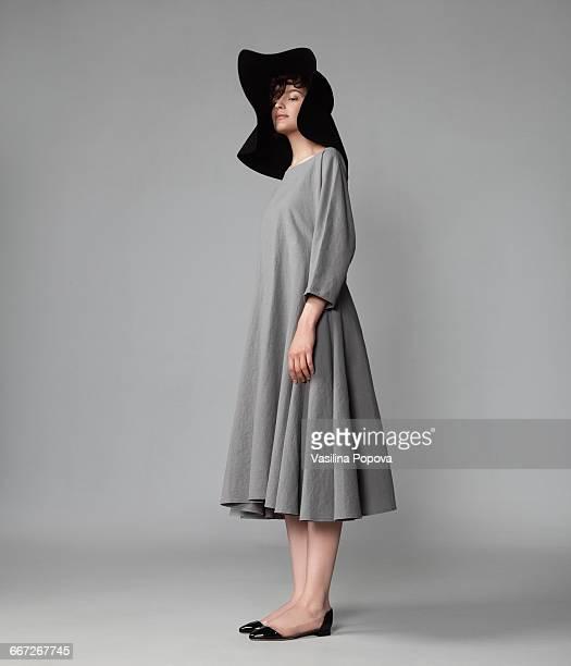 young elegant woman posing in studio - つば広 ストックフォトと画像