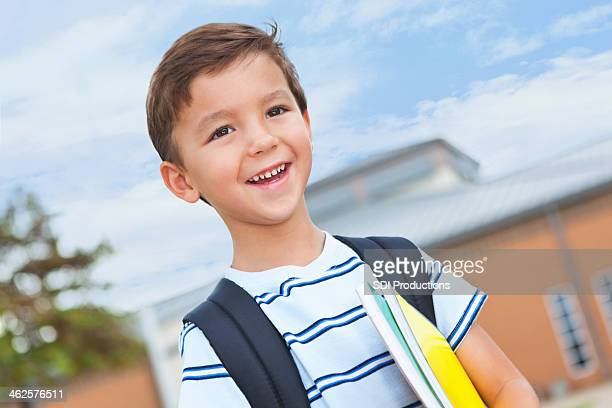 Young elementary school boy happy to be at campus
