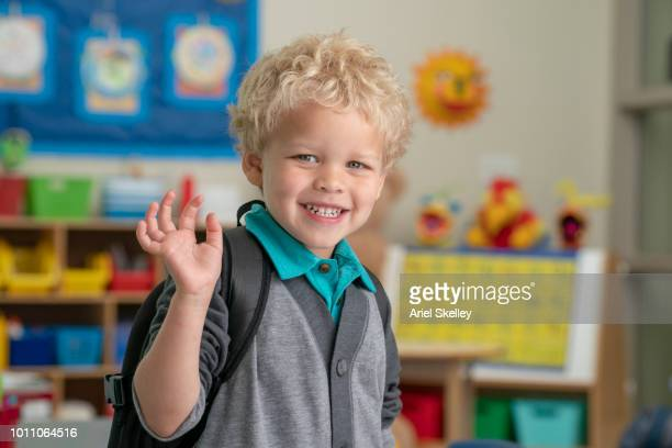 Young Elementary School Student Arriving in Classroom