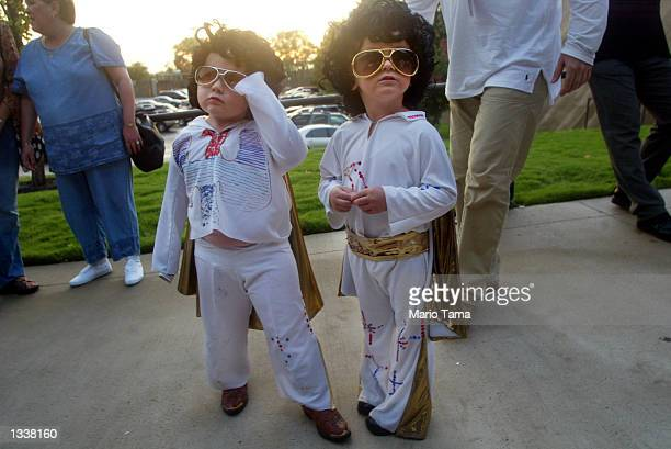 Young Elvis fans gather outside prior to the Elvis Presley 25th Anniversary Concert on August 16 2002 in Memphis Tennessee Up to 75000 fans were...