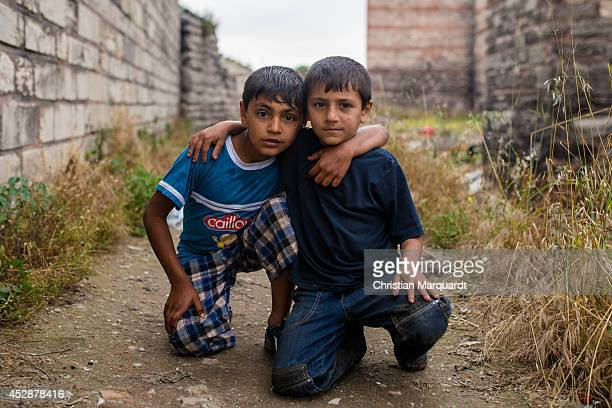 Young embraced boys together in the old Ottoman gardens which are located in Topkapi district are pictured on a cloudy day on June 7 2014 in Istanbul...