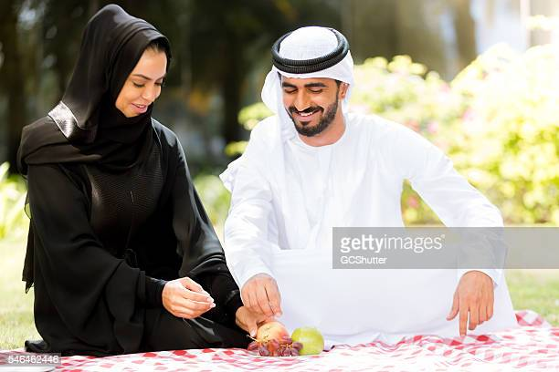 young emirati couple in dubai - national landmark stock pictures, royalty-free photos & images
