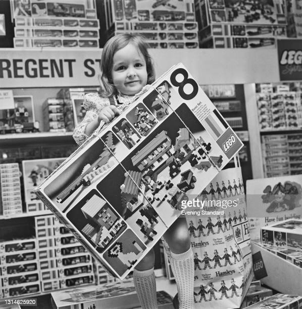 Young Emma Louise Avery holds a large box of Lego at Hamleys toy store in Regent Street, London, UK, 3rd May 1974.