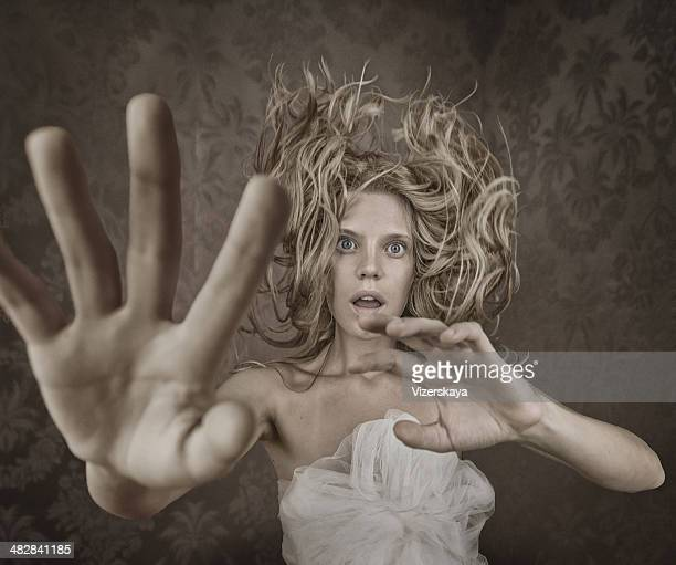 young emotional women with flying hair