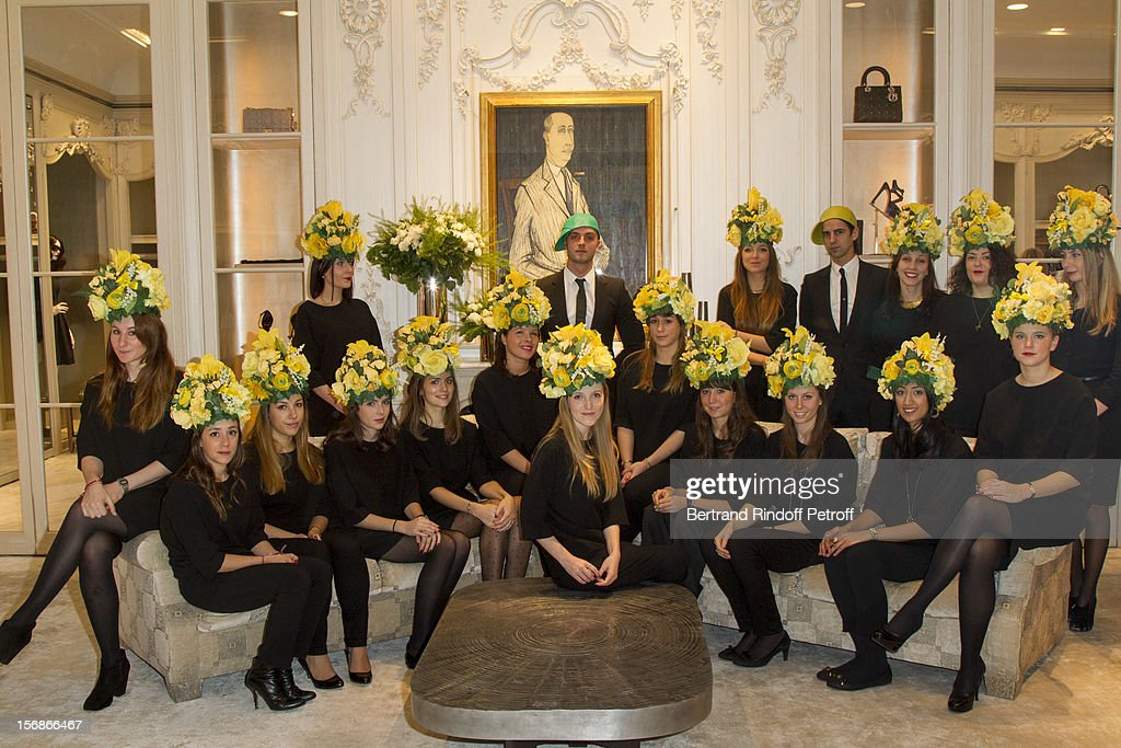 Young employees of the Christian Dior fashion house pose at the Dior Boutique during the Sainte-Catherine Celebration on November 23, 2012 in Paris, France.