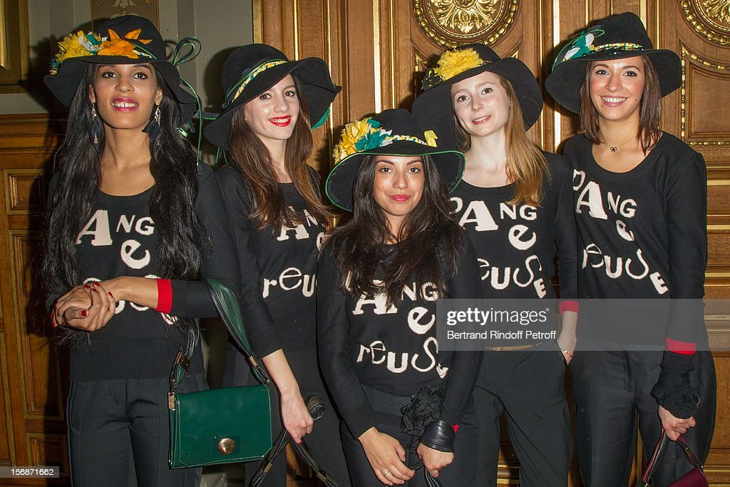 Young employees of the Sonia Rykiel fashion house pose at the Paris City Hall during the Sainte-Catherine Celebration on November 23, 2012 in Paris, France.