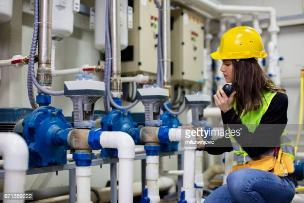 Young engineer at work in boiler room
