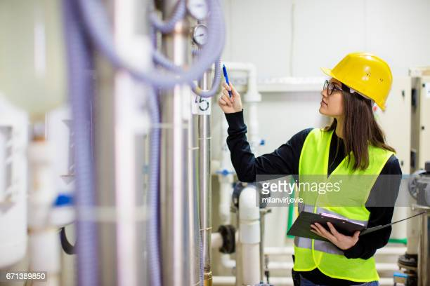 Young engineer controlling the process in factory