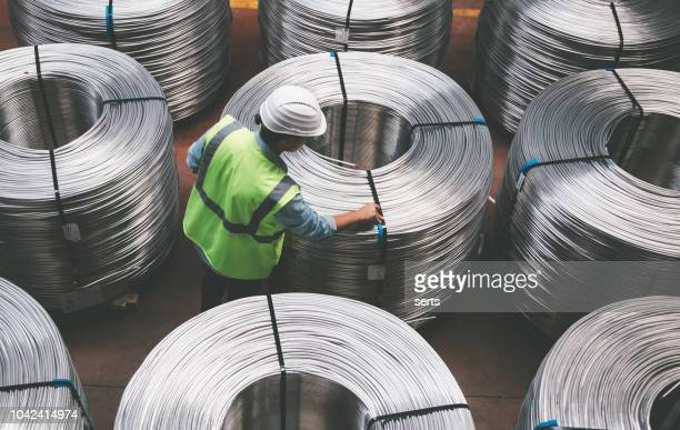 young engineer man checking production line in wire warehouse - cable stock pictures, royalty-free photos & images