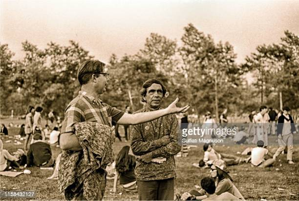 """Young """"engineer type"""" man asking a Native American man, """"What's going on here?"""" at the 1st Elysian Park Love-In on March 26, 1967 in Los Angeles,..."""