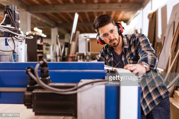 Young engineer working on the cnc machine