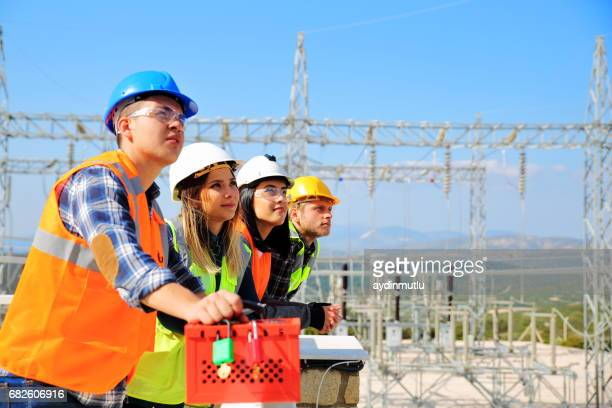 Young engineers working in electricity