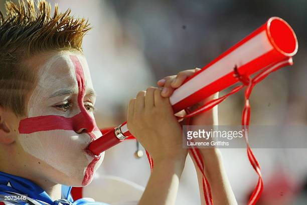 Young England fan blows a horn during the England v Slovakia European Championship 2004 qualifying match on June 11, 2003 at the Riverside Stadium in...