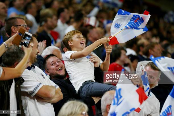 A young England fan celebrates during the UEFA Euro 2020 qualifier match between England and Kosovo at St Mary's Stadium on September 10 2019 in...