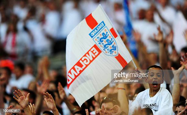 A young England fan cheers on his side during the International Friendly match between England and Mexico at Wembley Stadium on May 24 2010 in London...