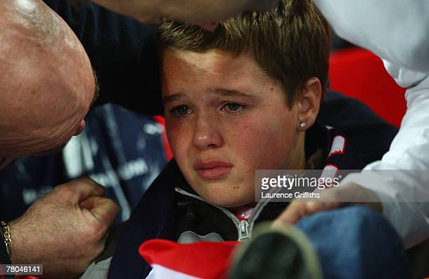 A young England Fan is consoled after the Euro 2008 Group E qualifying match between England and Croatia at Wembley Stadium on November 21 2007 in...