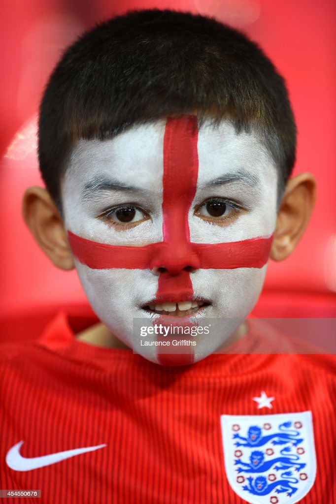 A young England fan looks on during the International friendly match between England and Norway at Wembley Stadium on September 3, 2014 in London, England.