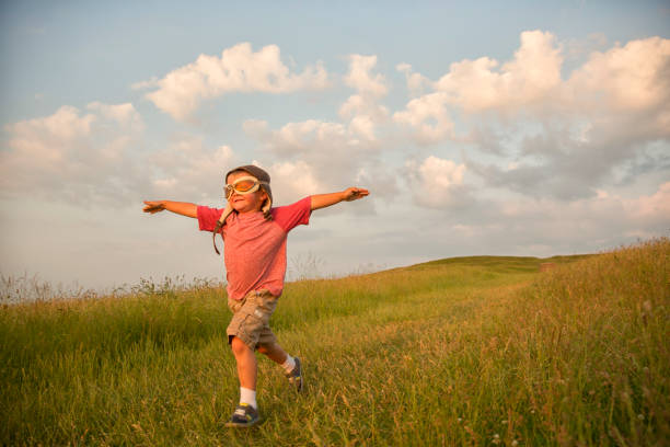 Young English Boy Imagines Flying On Hill Wall Art