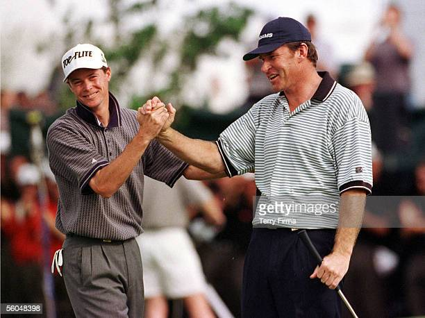 Young English golfer David Carter congratulates teammate Nick Faldo on the 18th green, after their win in the World Cup Of Golf at the Gulf Harbour...