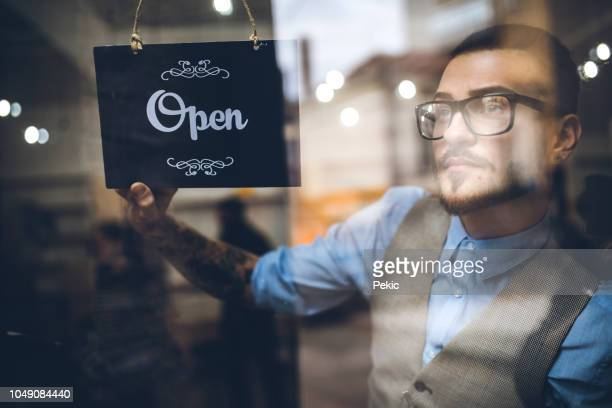 young entrepreneur opening store - entrance sign stock pictures, royalty-free photos & images