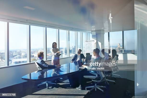 young entrepreneur presenting project in exclusive boardroom - negócio empresarial - fotografias e filmes do acervo