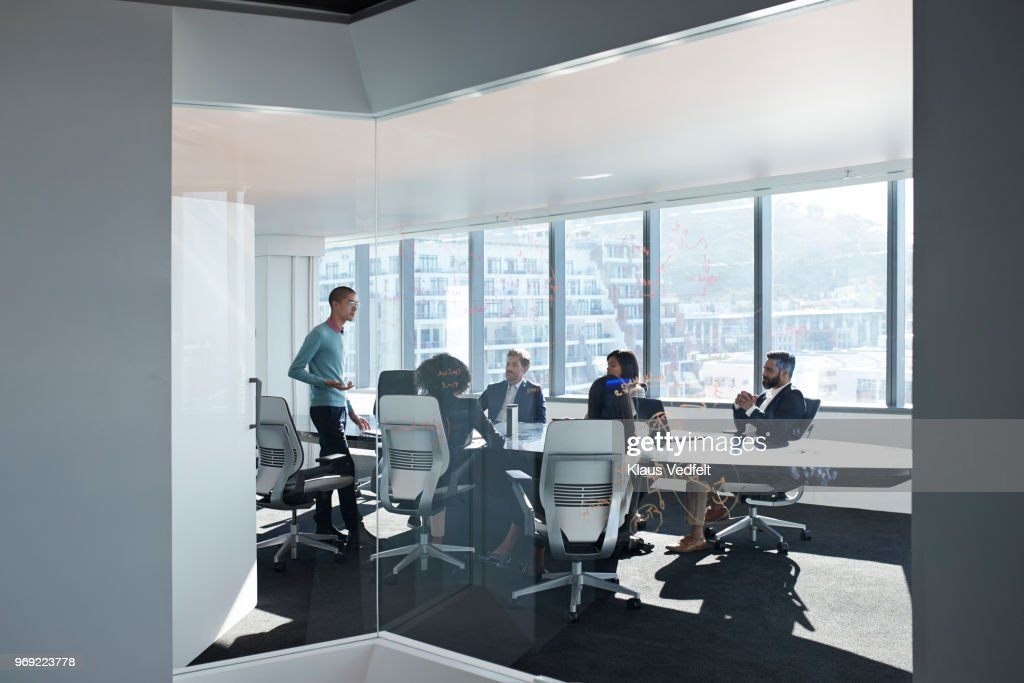 Young entrepreneur presenting project in exclusive boardroom : Stock Photo