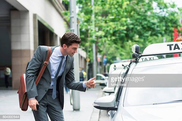 young entrepreneur thanking taxi driver - taxi driver stock photos and pictures